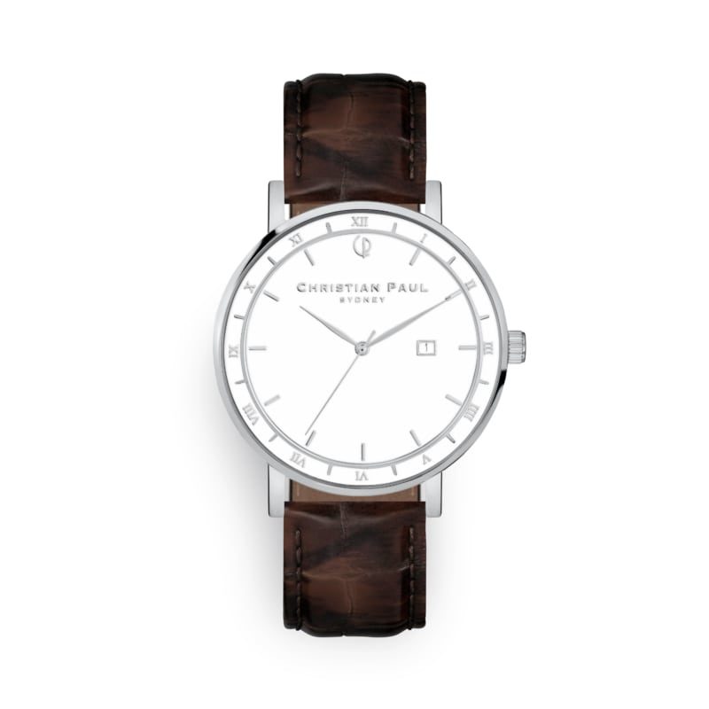 Roman numeral watch with brown strap