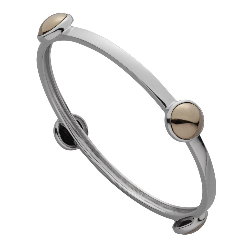 Najo bangle with four round brass stations