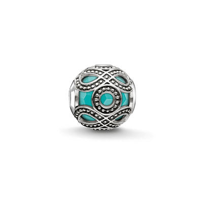 Silver and recon. turquoise ethnic Karma Beads charm