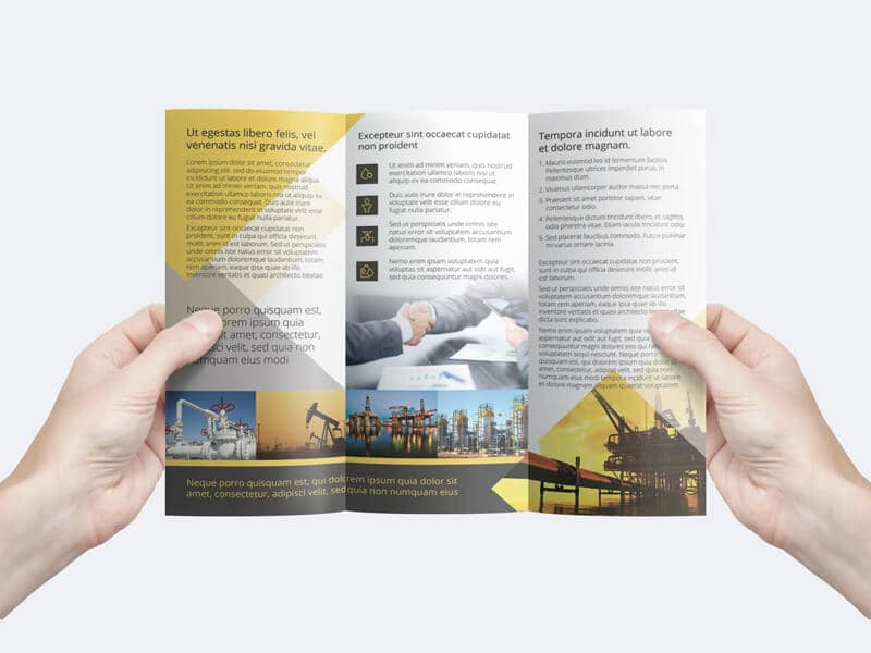 free man holding a trifold flyer template creativebooster