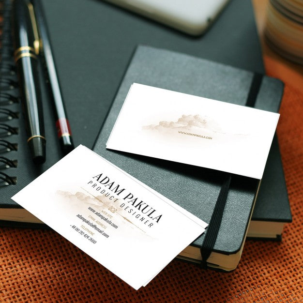 Free business card mockups with notebook and pens creativebooster free business card mockups with notebook and pens colourmoves Gallery