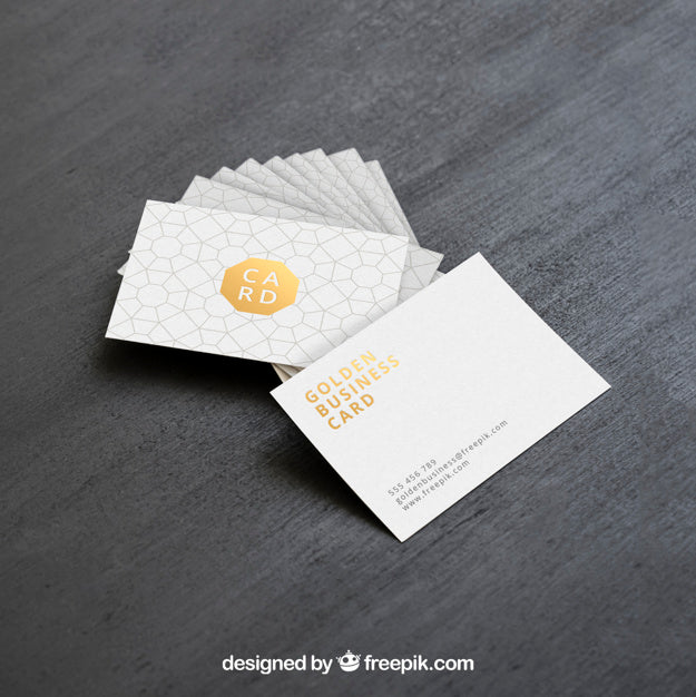 Free business card mockups creativebooster free golden clean business card mockup colourmoves