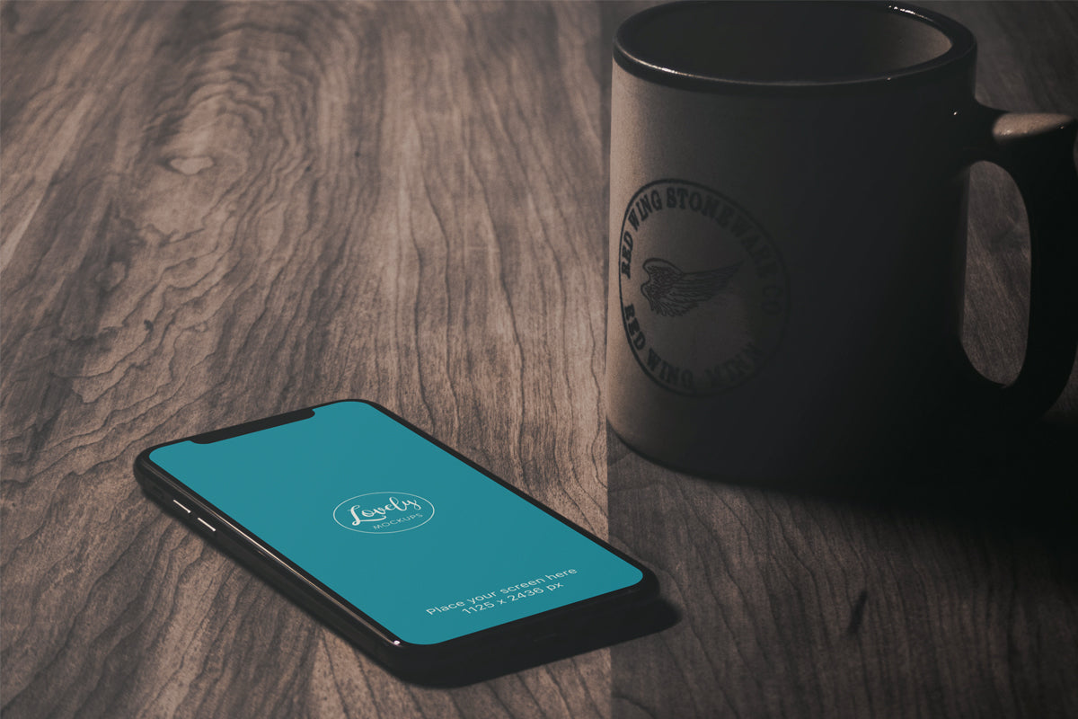 Free Iphone X Mockup On A Vintage Wooden Table Creativebooster