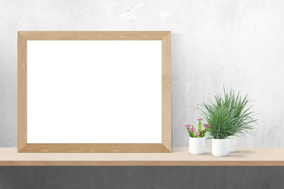 Free Wall Frame White Poster Photo Mockup - CreativeBooster