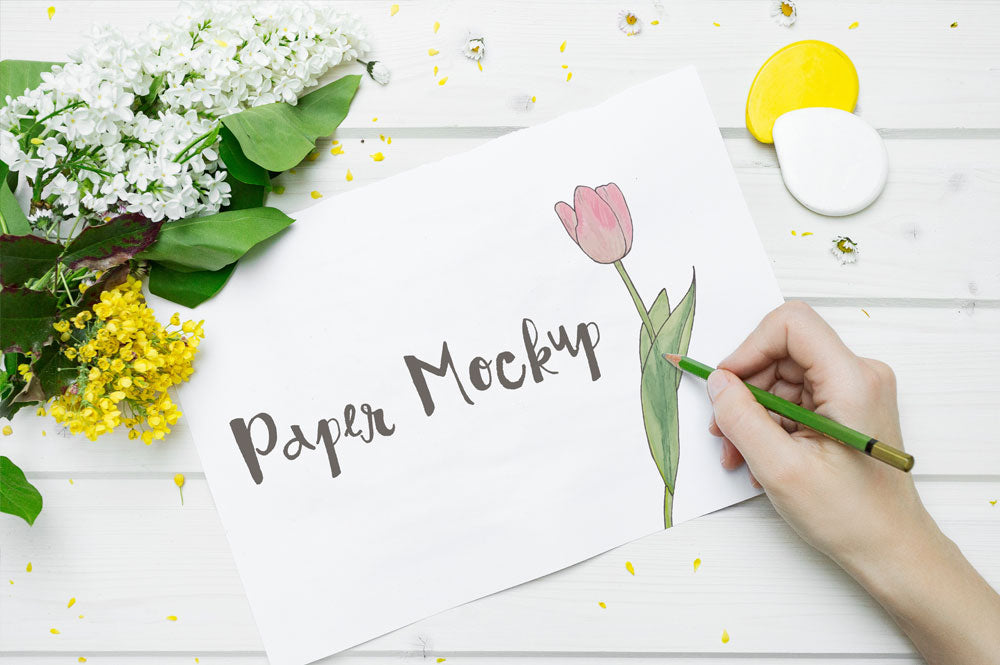 Free High Resolution White Sketch Paper Mockup with a Hand