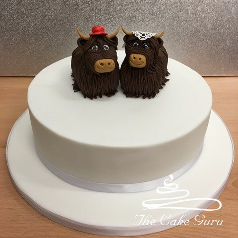 Highland Cow Bride and Groom Wedding Cake