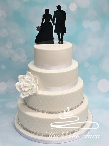 Scottish Groom in Kilt and Bride Wedding Cake