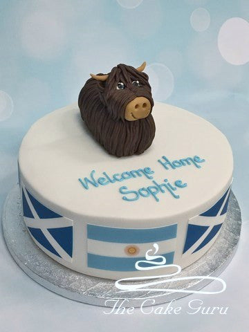Highland Cow Welcome Home cake