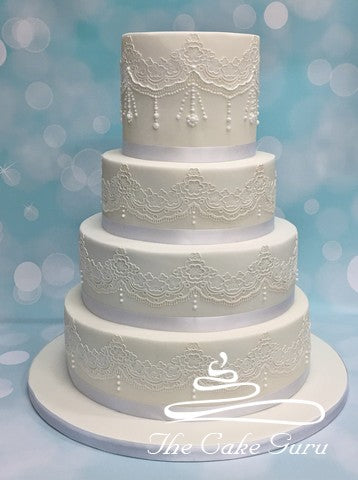 Lace With Added Piped Detailing Wedding Cake