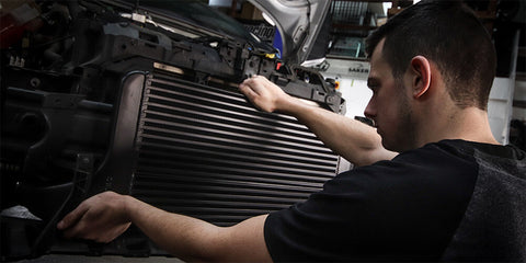 intercooler being fitted by technician