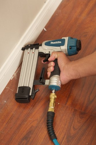 Highly suitable for skirting boards this image is a close of  the Makita AF505N Brad Nailer in action