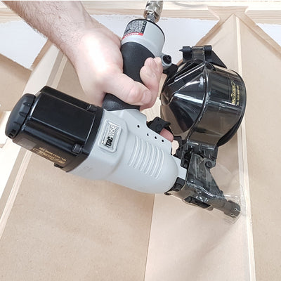 DCN50LHH2 Tacwise 2.1 Conical Mini Coil Nailer in joinery workshop on stairs