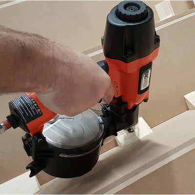 FCN65V Tacwise Flat/Conical Coil Nailer (25-65mm) in a workshop fixing balustrade