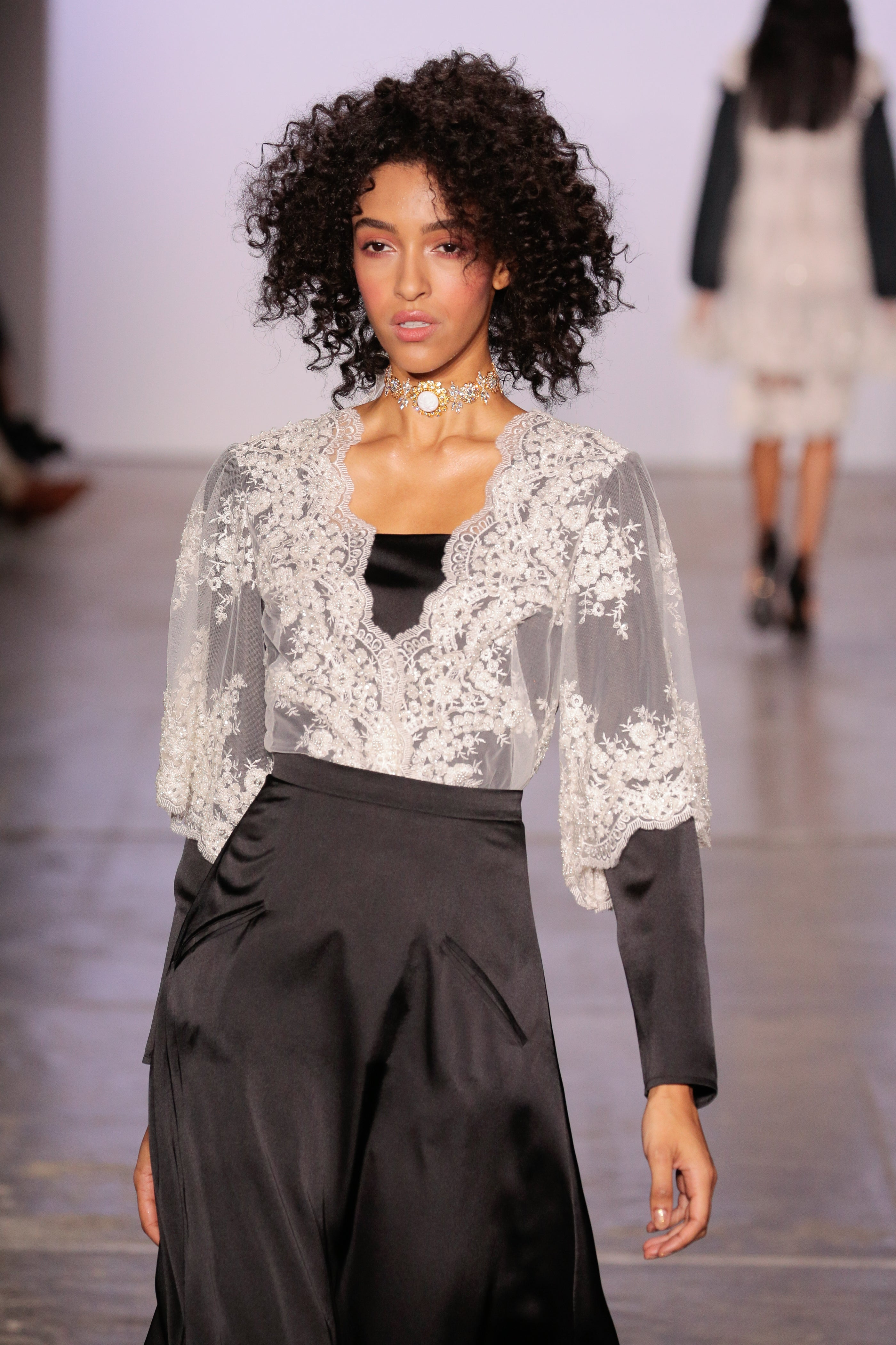 BLACK SILK TOP WITH WHITE EMBROIDERY