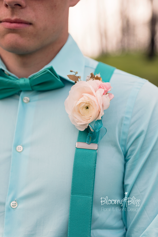 Groom Cody's bout featured an amazing pastel ranunculus and seeded eucalyptus.