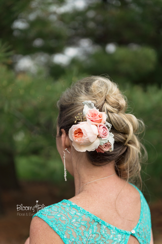 Mother-of-the-bride wore a garden rose hair comb in lieu of a corsage.  Beautiful!