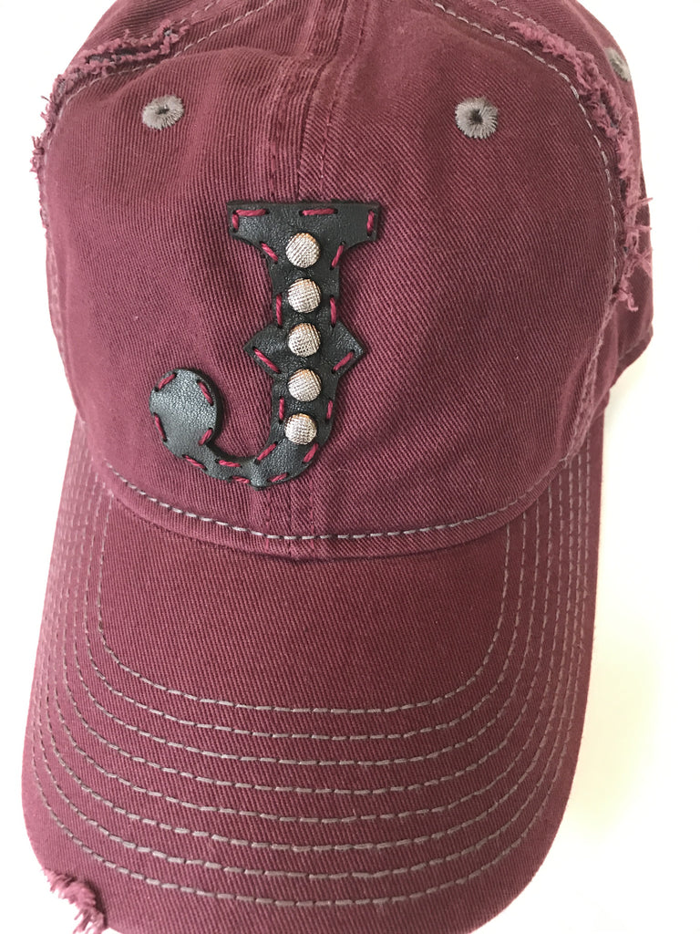 Burgundy and gray distressed baseball cap with hand studded, hand stitched leather initial