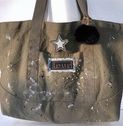 100% cotton canvas khaki tote bag with studs, splatter paint and leather patch
