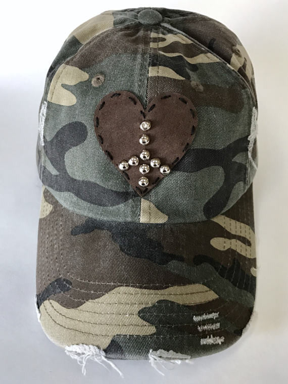 distressed and adjustable camo cap with hand studded peace sign on suede hand stitched heart patch