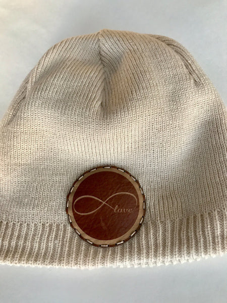 Fleece lined beanie hat with infinity love leather patch