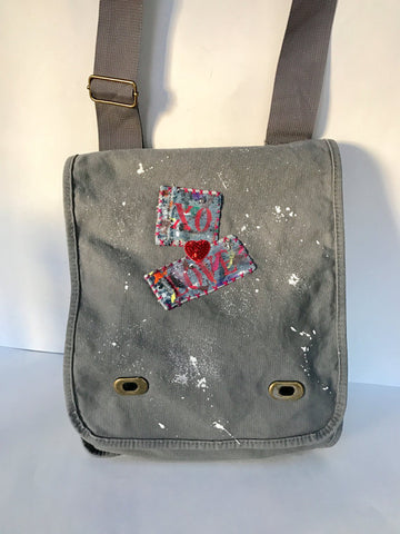 Gray cotton canvas field bag with white splatter paint and vintage distressed denim patch details