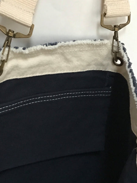 Raw edge tote with leather patch and chain trim