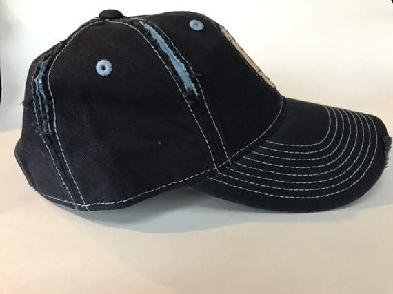 adjustable navy blue and light blue two tone distressed cotton cap with embroidered butterfly leather patch