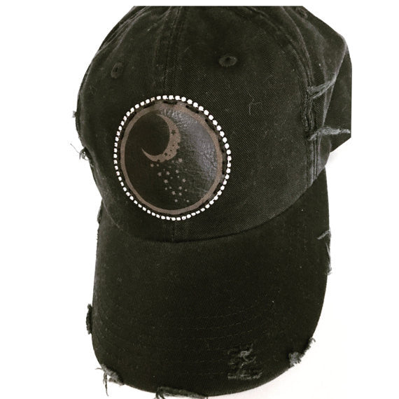 black distressed cap with leather moon and stars patch and bling trim