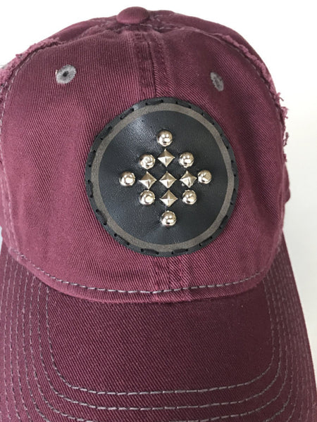 burgundy and gray distressed adjustable cap with studded leather patch