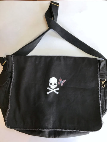 raw edge messenger bag with handpainted skull and crossbones and butterfly