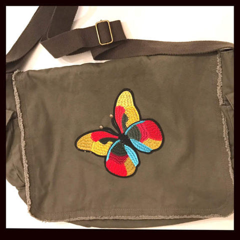 messenger style Olive/khaki bag with embroidered 70s/vintage inspired butterfly patch and floral studded antennas