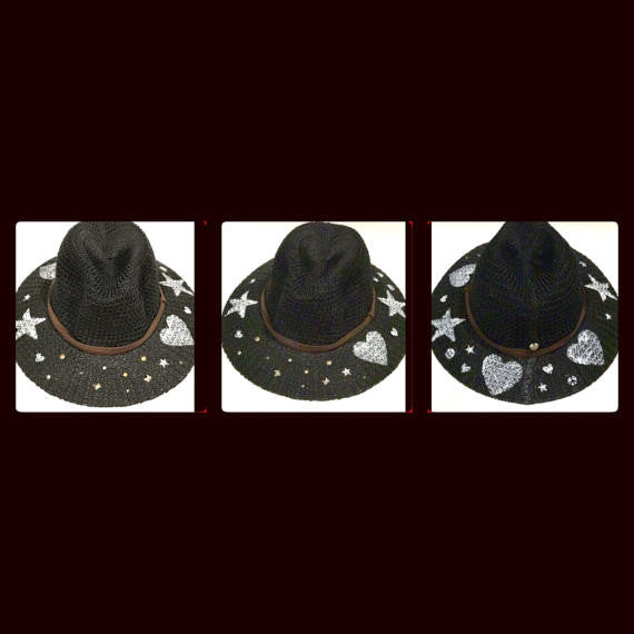 one size fits most black fedora with faux brown suede band, hand painted hearts and stars and hand studded