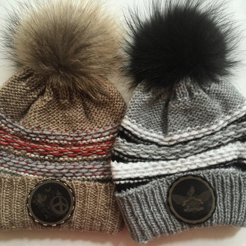Choice of black or brown slouch fur pom pom beanie with leather patch