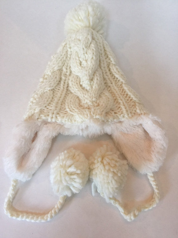 Ivory acrylic cable knit trapper hat with pom pom