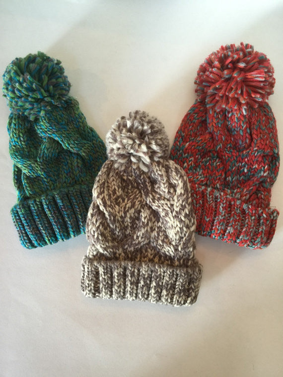Pompom knit cap with choice of blue/green, gray/cream, or red/gray with custom guitar pick