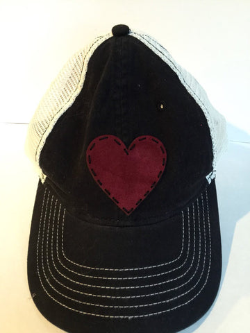 Choice of black or gray trucker style snapback cap with red or blue suede heart patch