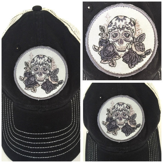 Black & cream trucker style cap with embroidered floral skull patch