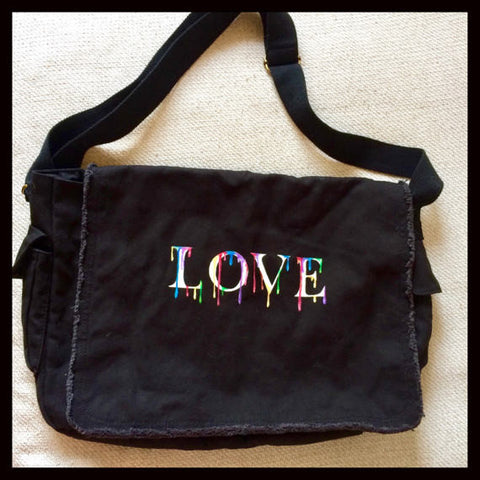 canvas hand-painted messenger bag with your choice of the word LOVE or PEACE and multi color paint drip design.