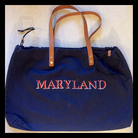 Your choice of gray or navy, hand painted school or zodiac sign on canvas tote with side pulls