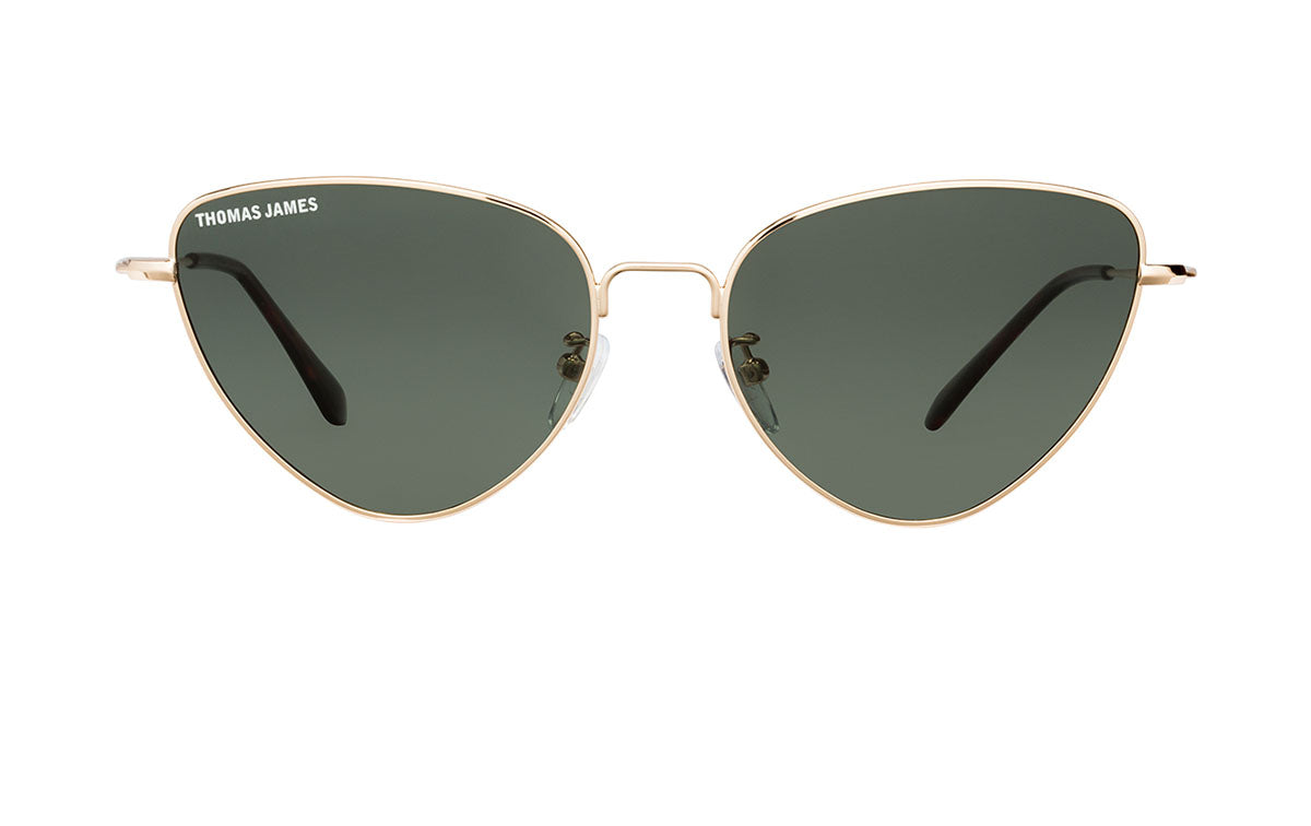 01-1991: Petit frame in triangle cat-eye shape with thin gold metal frame, thin gold metal temple with tort tip.  Solid smoke classic green color lens.  POLARIZED.  UV400