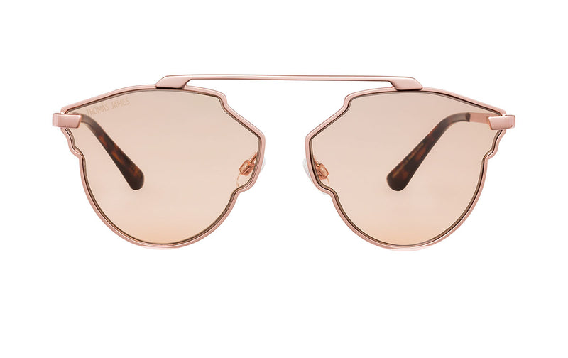 02-Peach: Scalloped frame with single brow bar in glossy rose gold frame and temple.  Transparent solid peach color lens with tort ear tip.  UV400