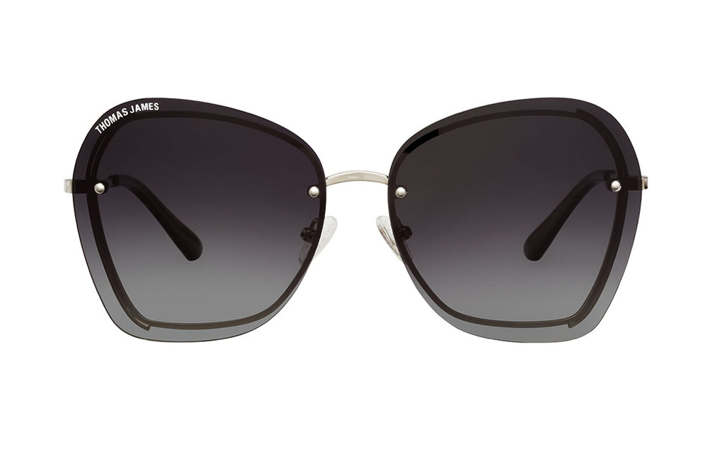 02-Storm: Frameless 70's style sunglass with gradient charcoal color lens with metal trims in silver color.  Glossy black polycarbonate ear tip - POLARIZED. UV400