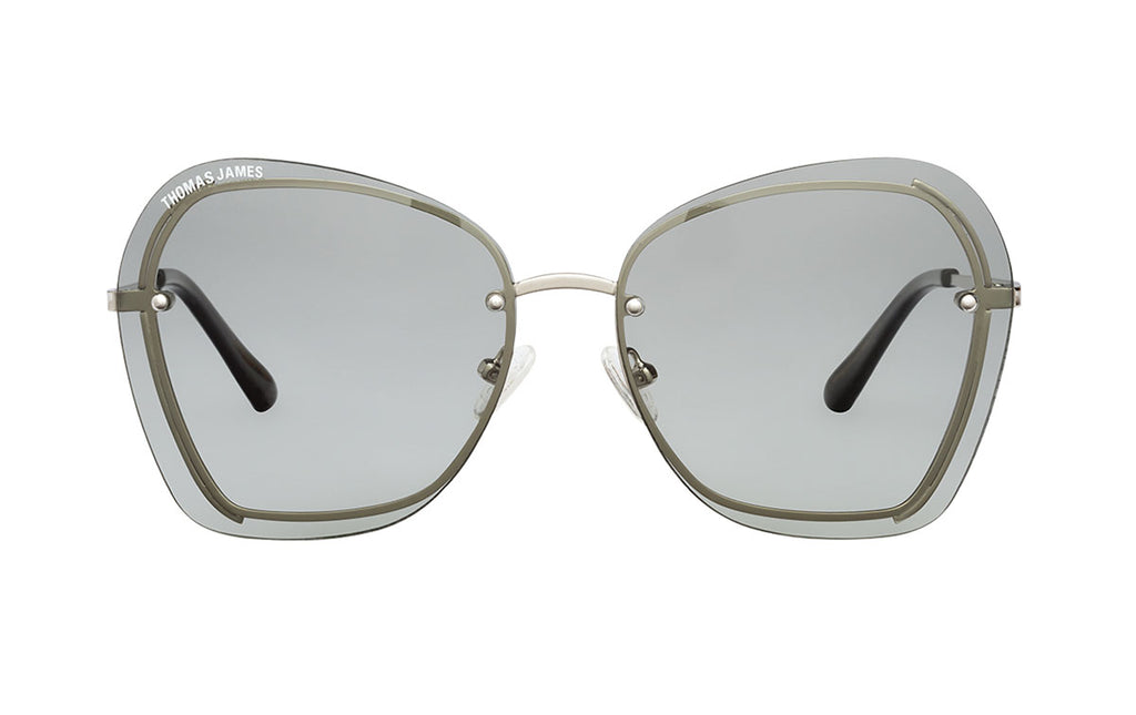 03-Ice: Frameless 70's style sunglass with solid light gray color lens with metal trims in silver color.  glossy black polycarbonate ear tip - POLARIZED. UV400