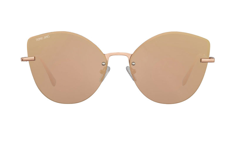 03-Mocha: Rimless round rose gold cat eye frame with small shiny rose gold detailing on the mirrored rose gold UV400 lens