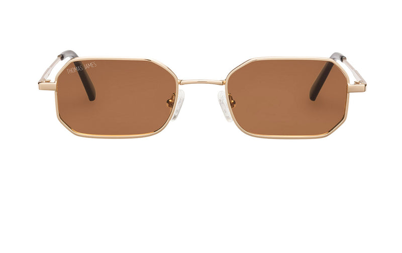 01-Speedy: Petite sized wide octagon Gold frame with solid  brown lens.  Rigid temples with POLARIZED, UV400
