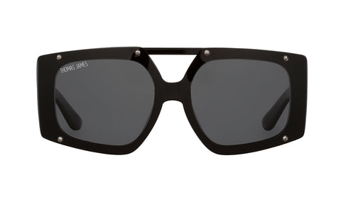 02-Olive: Oversized black rectangular frame with silver hardware on lens. Solid black transparent POLARIZED UV400 lens