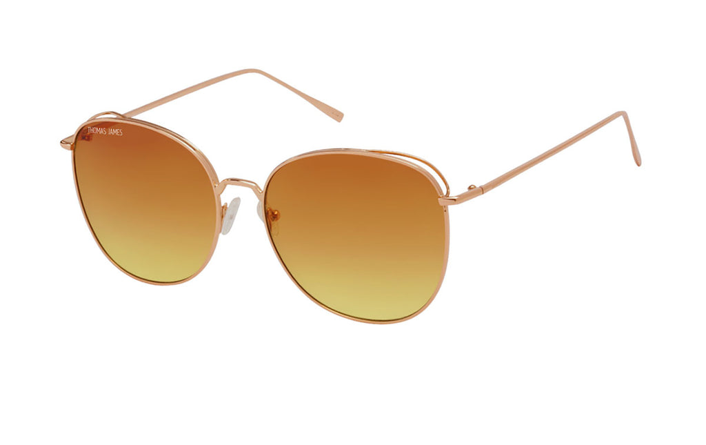 02-Issac: gold glossy metal frame with amber gradient lens.  Butterfly frame.