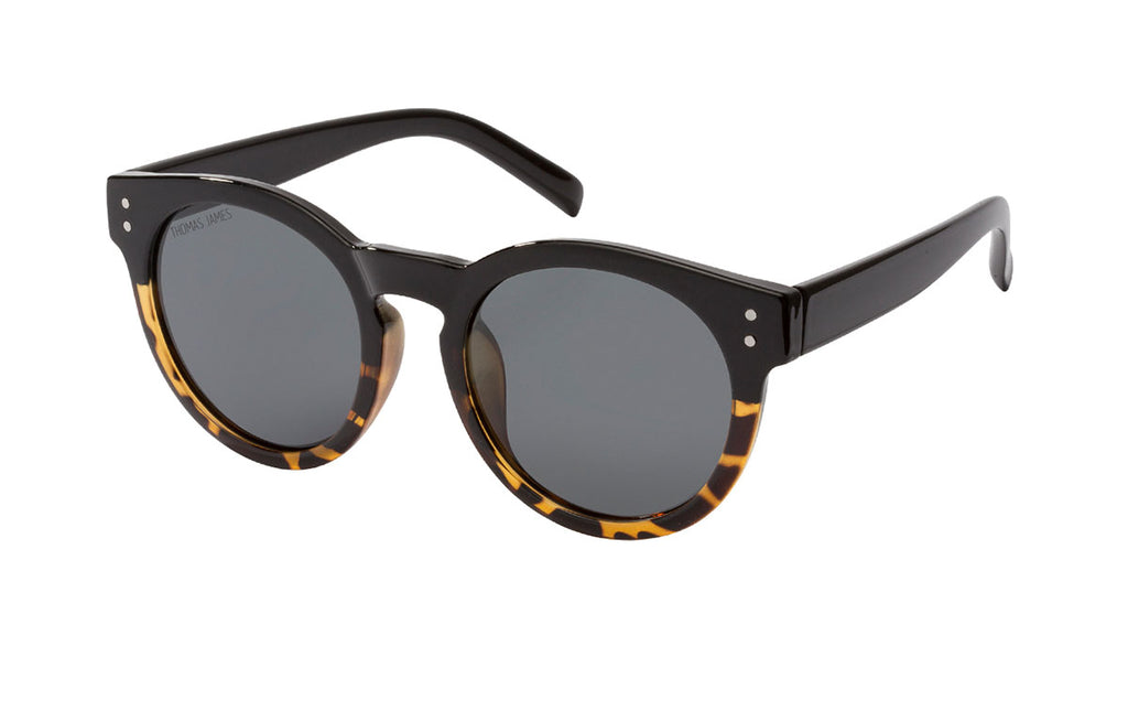 02-Black: Classic style with twist.  Upper frame is back with gradient tortoise towards the bottom of the frame with black temple.  PC frame with solid black PC lens.  UV400, Polarized, high quality hinges.