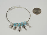 Paradise Parrot Head Wire Bracelet with Five Charms and Blue Beads B-JBBR