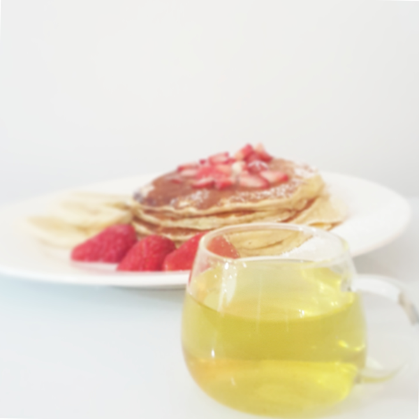 Pancakes with strawberries and bananas, paired with No 1, Light Fresh Scent Iron Goddess Tea.